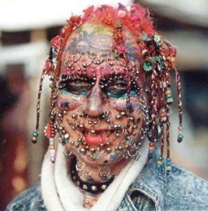Body piercings. A lot of body piercings.