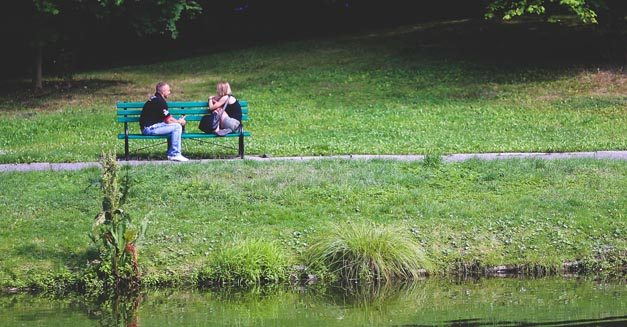 Couple talking on a bench