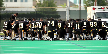 football players kneeling